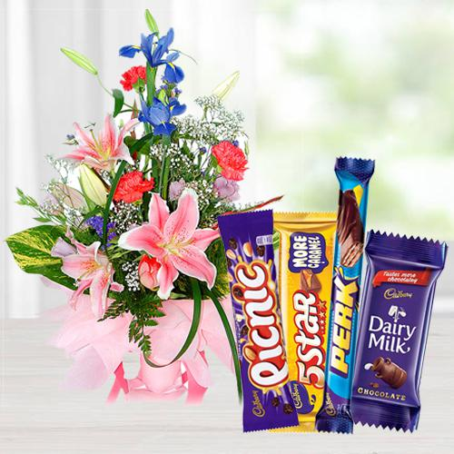 Charming seasonal Flowers with mouth-watering mixed Cadburys Chocolate