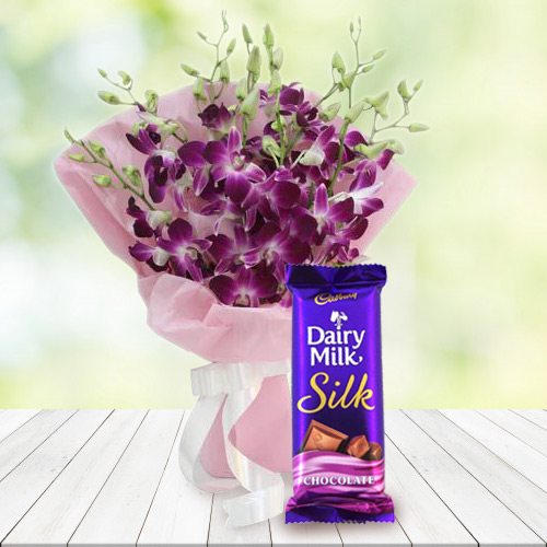 Birth-Day Enjoyable Combo of Cadbury Silk and Orchids Bouquet