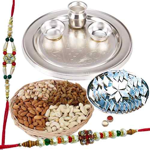 An amazing Silver plated Thali, <font color=#FF0000>Haldiram</font> Kaju Katli, Dry Fruits with free Rakhi, Roli Tilak and Chawal