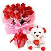 Cute Teddy Bear with a Cluster of Red Roses