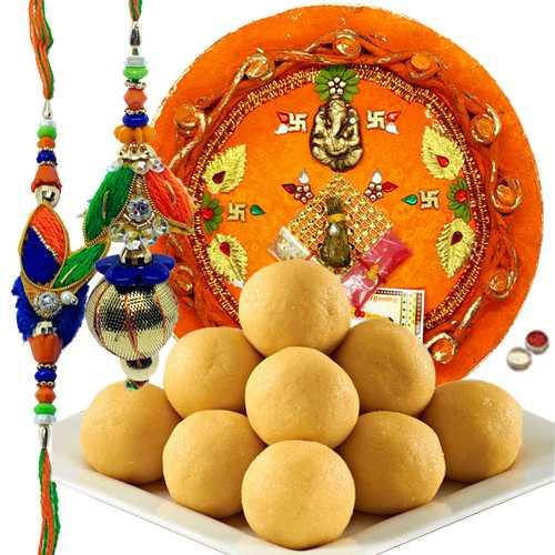 Graceful Set Of Bhaiya Bhabhi Rakhi, Pooja Thali And Luscious Besan Laddoo