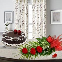 Magnificent 3 Red Roses with 1/2 Kg Chocolate Cake to Rajgarh Colony