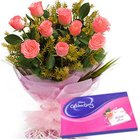 Gaudy Pink Roses Hand Bunch with Cadbury Assortment to Pragati Maidan