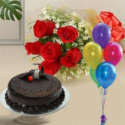 Garnished 1 Kg Chocolate Cake with 6 Red Roses and 5 Balloons