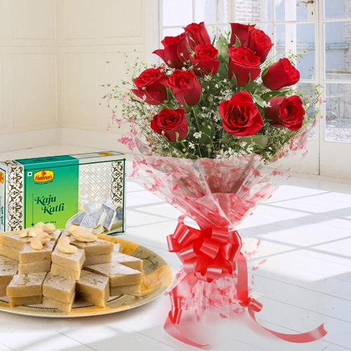 Charming Red Roses Combined with Mouthwatering Kaju Katli