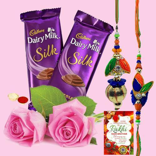 2 Dairy Milk Silk with Bhaiya Bhabhi Rakhi, 2 Pink Roses & Free Rakhi Card