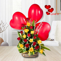 Multicolored Roses arrangement with Red heart shaped Balloons