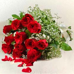 Luminous Bouquet of 12 Red Roses for Sweet Surprise to Nathupura