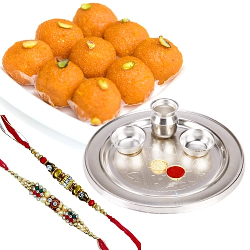 Pride-to-Possess Silver Plated Thali with <font color=#FF0000>Haldiram</font> Ghee Ladoo & 2 Designer Rakhi and Roli Tilak Chawal