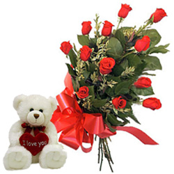 12 Red Roses Bunch with a small teddy bear to Gandhi Nagar